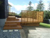 Marks deck - New deck built with merch grade pine, Boxed stairs, trellis, boxed in deck underneith with landscaping work.