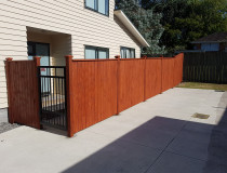A shiplap fence in ranui - Constructive Solutions North Island Ltd - This fence was made for customers in ranui and stained in a warm kwila colour