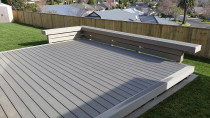 Permadeck composite deck with seating area completed by DECKHQ