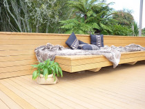Verda honey gold deck and seating area completed by DECKHQ