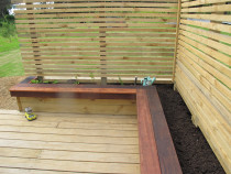 Planter box and seating area by DECKHQ