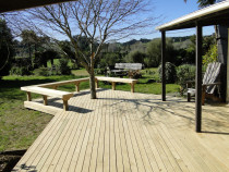 Pine deck with seating area by DECKHQ