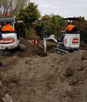 Discount Drainage Ltd - Our 2 Bobcat Excavators - Digging trenches for drainage at 3 houses in Kaikoura