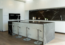 White Gloss - White high gloss cabinetry finish with marble bench top.  Handle-less design with push to open doors and draws