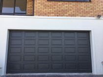 Garage Door repainted by H2GLO Services - Garage door completed repaint after repairs and prepped for final coatings.