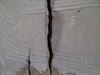 Water Tank Damage - Healthy Water Solutions - Deep vertical crack that drained the tank.