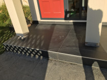 Front porch in Johnsonville by HEK Tiling Ltd - Had to remove existing 20 years old tiles and changed to this. Client loves it.