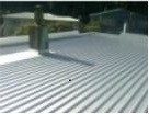 MC 700 Longrun - Zincalume finish over new battens replacing standing seam roof in December 2011