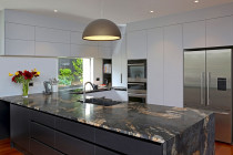 Jag Kitchens - A beautiful gold-honed granite benchtop adds the wow factor to this kitchen design.