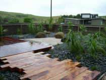 Omaha Beach - Kwila deck, macrocarpa boardwalk, paving, boulder seats, planting