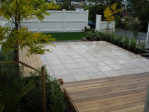 Takapuna: - Vitex deck, large paved courtyard, large bench seat, planting, retaining
