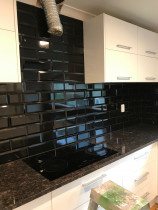 Black bevelled subways by Just Splashbacks - Female Tiler