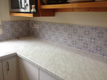 Blue and cream retro picture tiles by Just Splashbacks - Female Tiler
