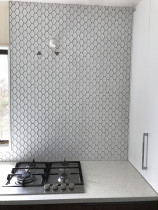 Scollaped mosaics by Just Splashbacks - Female Tiler