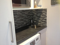 Mosaics around laundry tub by Just Splashbacks - Female Tiler