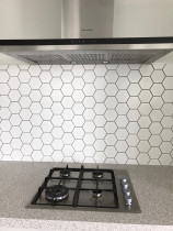 Hexagonal mosaics vy Just Splashbacks - Female Tiler