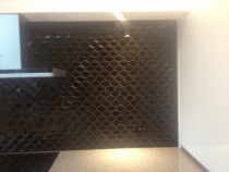 Closeup Black hexagonal tiles - will darken a room