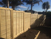 Horizontal trellis panel fence and retainer with garden by K Benson Contracting Ltd t/as KB Contracting