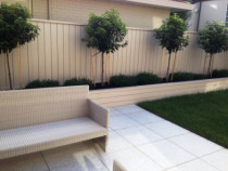 Classic, simple design, Milford - Jagas paving and readylawn, machine gauged planters and fencing, standardised trees with groundcover.