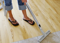 Vacuuming hard flooring with a wheel brush - Use a scratch resistant vacuum head to prevent your floors from being scratched with a Kiwivac accessory