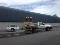 Commercial building wash with use of scissor lift and harness equipment