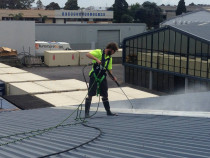 Commercial roof clean with full safety harness set up to ensure the job is carried out safely