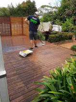 Water blast and re-staining of old decks and trellis