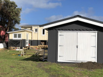 Newly painted exterior work - Recently painted exterior of cabins in Piha, Auckland by Paint Crew.