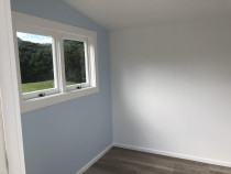 Interior paint work - Recently painted interior of cabins in Piha, Auckland by Paint Crew.
