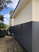 New exterior paint work - Recently painted exterior of cabins in Piha, Auckland by Paint Crew.