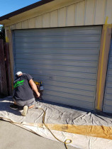 Repainting old garage doors to modernise exterior