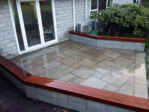 Natural Stone Paving with Kwila Seating by Pure Style Home & Garden