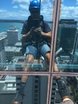 Reflect Cleaning - Abseil window cleaning on Deloites building on Queen St Auckland