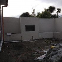 Solid Plaster fireplace and retaining walls