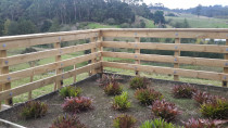 post an rail around garden - This post and rail fence was also retaining wall below to support garden
