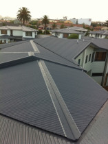 Sacramento Housing Development, Botany - Complete replacement of roofing to Sacramento Housing Development for Canam Construction.  The project comprised 153 houses and 107 garages in 0.55 Endura Colorsteel in Grey Friars, complete with quad guttering and 80mm downpipes.