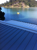 Residential Roof, Kawau Island - Installation of insulated panel to residential dwelling at Swansea Bay, Kawau Island, including an assortment of flashings.