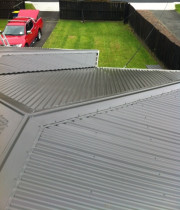 Sylvan Avenue, Northcote - Removal of 200m2 asbestos roofing and replacing with 0.4mm corrugate Endura Colorsteel in Ironsand, complete with ridge flashings, valley flashings and hips.