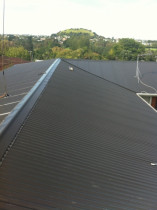 Lake Road, Devonport - Removal of 375m2 metal tile roofing and replacing with 0.4mm corrugate Endura Colorsteel in Ironsand, complete with all associated flashings.  The contract was for 4 units in the block.