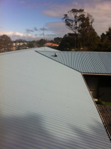 Lonely Track Road, Albany - Removal of 350m2 decramastic roofing and replacing with 0.4mm corrugate Endura Colorsteel in Alpine Blue, complete with ridge and valley flashings, replacement of timbers and insulation.