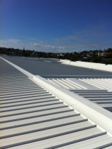 Retail Building, Half Moon Bay Marina - Installation of 2,000m2 insulated panel to new retail centre at Ara Tai, Half Moon Bay.  The contract also included 17 complex penetrations and an assortment of flashings.