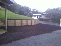 Retaining Wall / Metalled Parking Area
