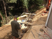In-ground retaining wall in progress