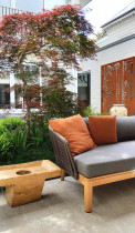 Seed Landscapes - Asian courtyard - Seed Landscapes designed this Asian influenced courtyard complete with corten bamboo patterned screens, a tiled patio with feature trees, pots, water-feature and pergola and project managed the build.