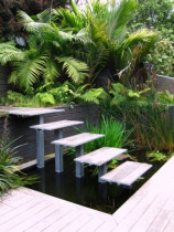 Seed Landscapes - Floating steps - A pond with plants and fish and access to the upper level
