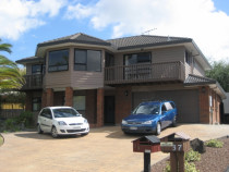 Cedar home painted by Shoreline Property Services Ltd