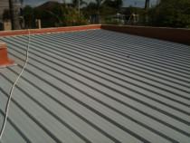 Roof painting by Shoreline Property Services Ltd