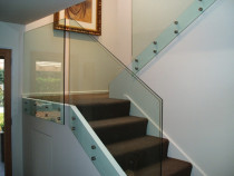 Face fixed glass staircase balustrade by Shower Solutions