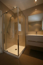Semi-frameless shower polished chrome by Shower Solutions