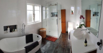 Modern Bathroom Renovation - An outdated bathroom vibrantly transformed thanks to our expert Builders